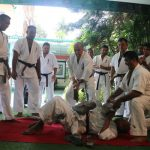 Stones weighing about 70 kg were broken with a hammer on the stomach of an 83 years old Karateka Upathissa Hewamadduma
