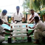Breaking of 4 ice slabs with the head by Branch Chief Liyanage